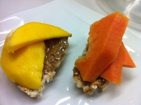Mango and papaya almond butter over organic brown rice cakes